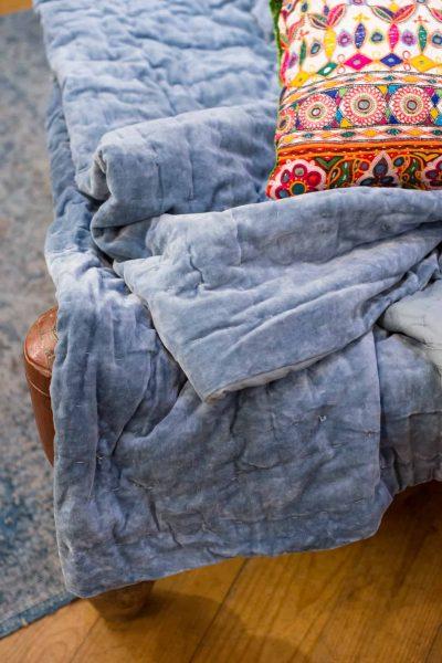 Blue velvet blanket with embroidered cushion