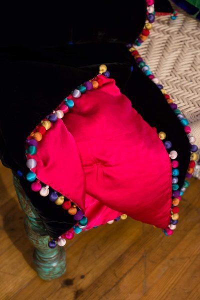 black velvet blanket with pink silk lining and silk balls