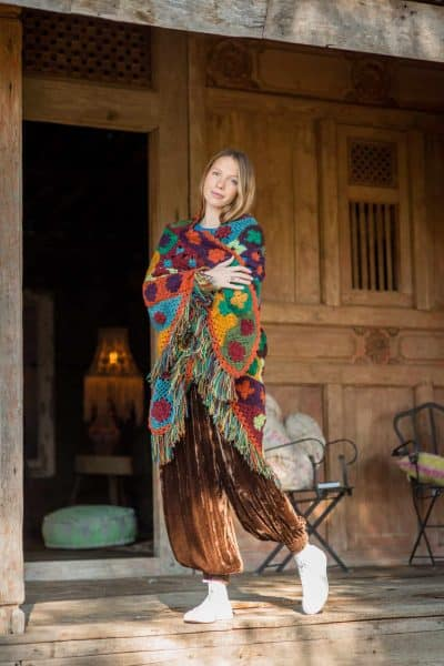 triangle shawl worn with brown velvet trousers