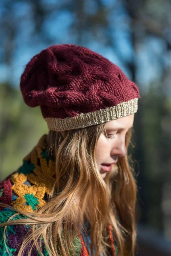 close up view of a burgundy knitted hat