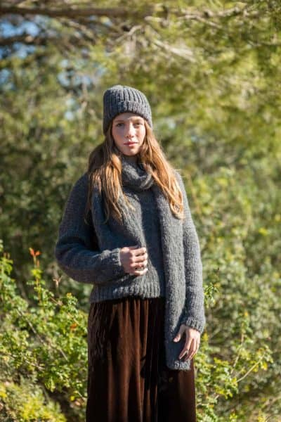 grey wool jumper worn with brown velvet trousers and a grey scarf and hat