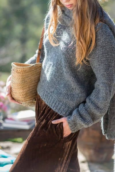 Broen velvet trousers worn with a grey jumper and scarf with an Ibiza basket