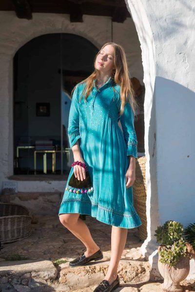 turquoise velvet dress with kantha stitch detail along the hems