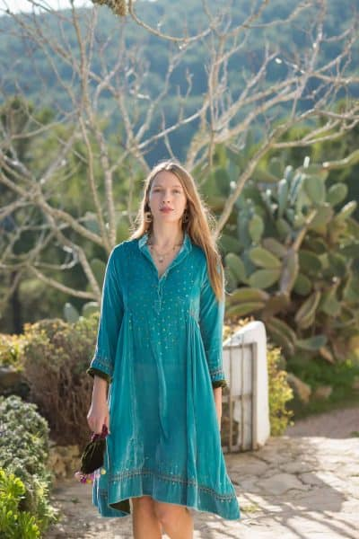 silk velvet turquoise dress with sequin detail and contrasting green hems
