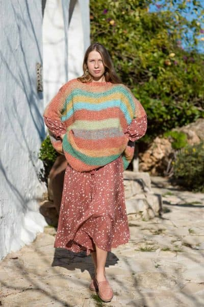 Striped mohair jumper layered over a terra coloured dress