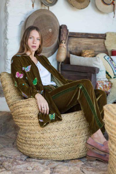 silk velvet olive green jacket worn with silk velvet trousers with a stripe