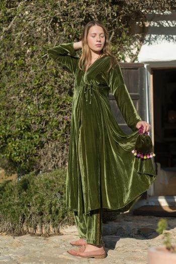 long velvet wrap around coat in green worn with matching trousers