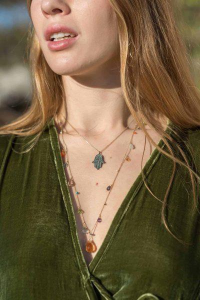 citrine necklace worn with a Hamsa hand diamond necklace