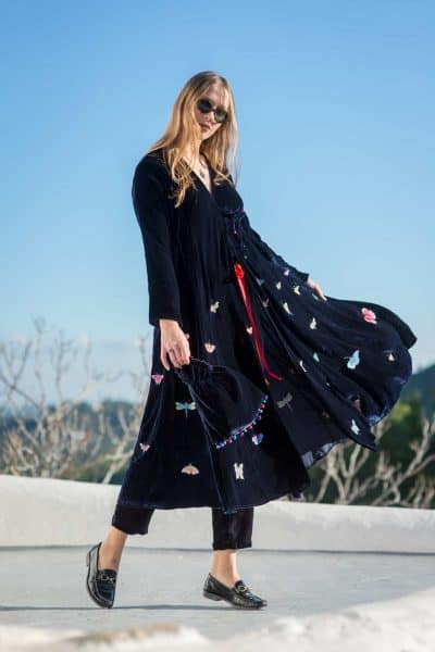 navy velvet coat with butterflies and a matching navy bag with silk balls