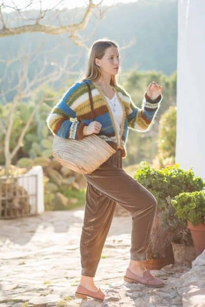 striped cardigan worn with velvet trousers