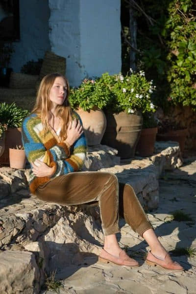 striped cardigan worn with golden olive green velvet trousers