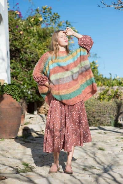 mohair sweater layered over a starry dress