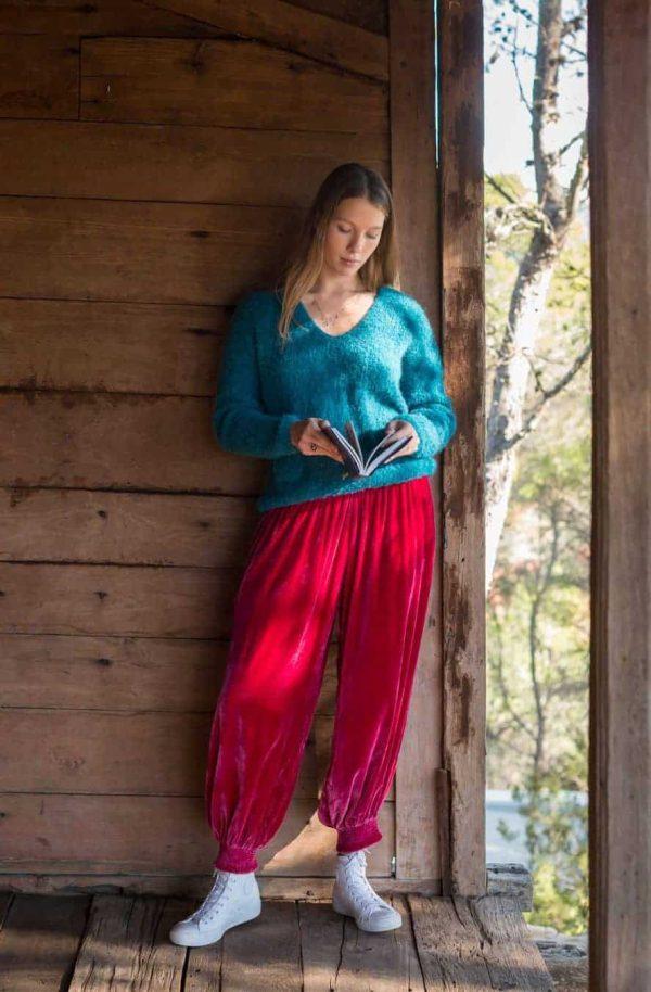 blue alpaca wool jumper with pink velvet trousers