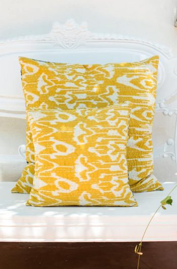 yellow ikat print kantha stitch cushion in small and large sizes