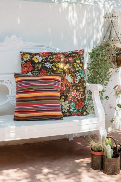 back and front of brown floral cushions with kantha stitch