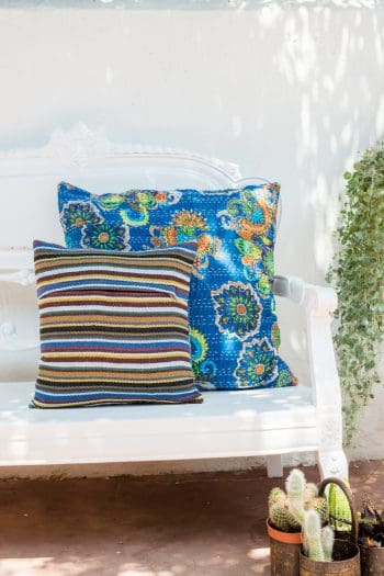 Back and front view of blue floral square kantha stitch cushions