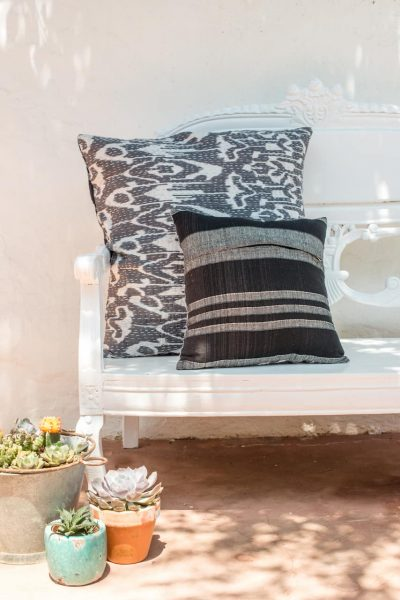 back and front view of grey ikat print cushions with kantha stitch