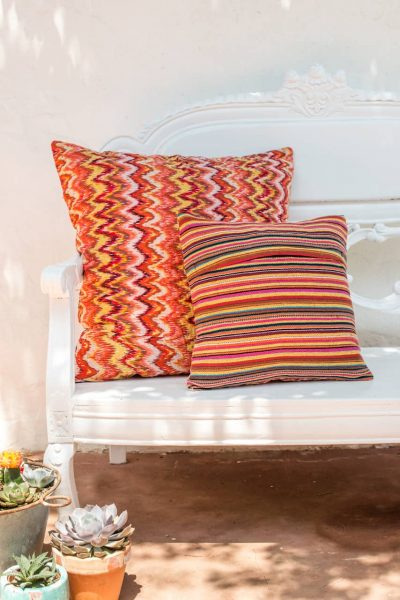 back and front of orange square kantha cushions
