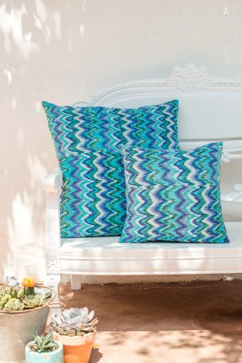 blue square cushions with a running kantha stitch across them