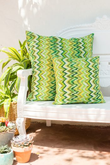 small and large green kantha stitch cushions