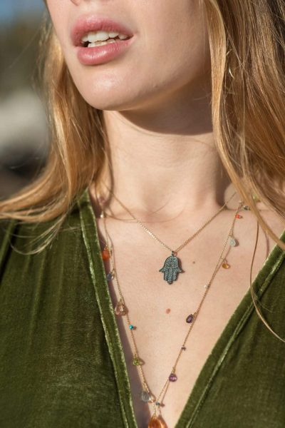 hamsa hand diamond silver rhodium necklace on a gold chain