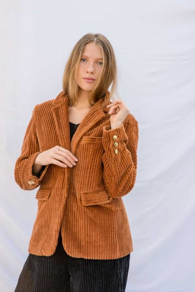 thick orange corduroy jacket with brass buttons, side pockets and a collar