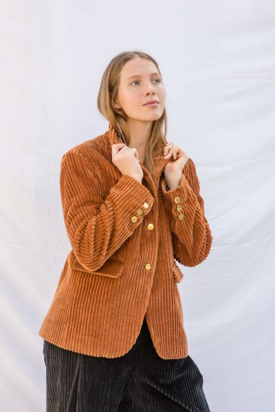 thick orange corduroy jacket with brass buttons and side pockets