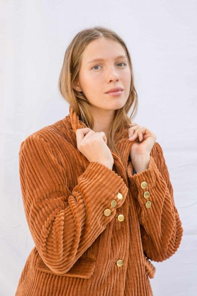 thick orange corduroy jacket with brass buttons