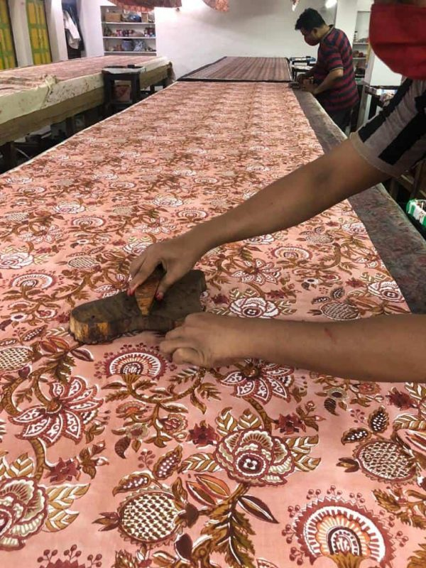 printing textiles by hand using wooden blocks