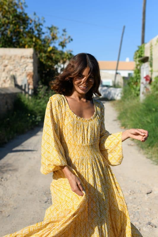 yellow dress with a white leaf print