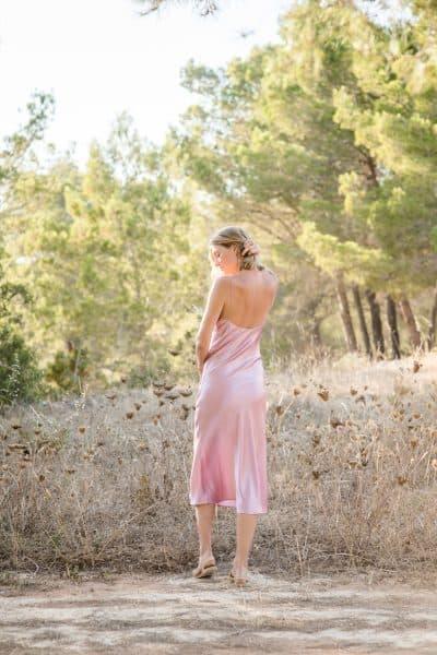 back view of slip dress in mauve silk