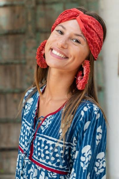 red raffia hoop earrings with a red silk headband