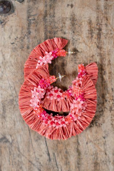 red raffia earrings in the shape of hoops