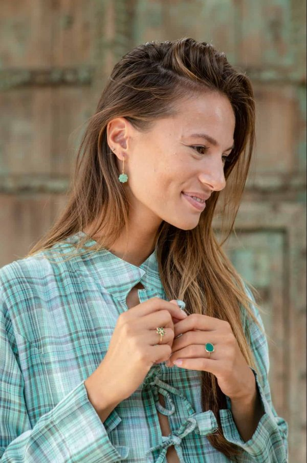 jewellery worn with a checked jacket