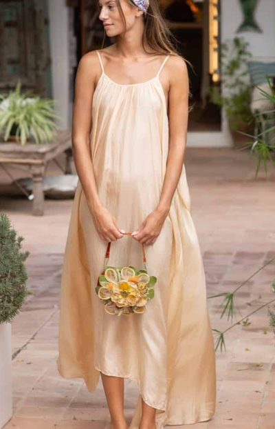 gold silk dress with pretty floral bag