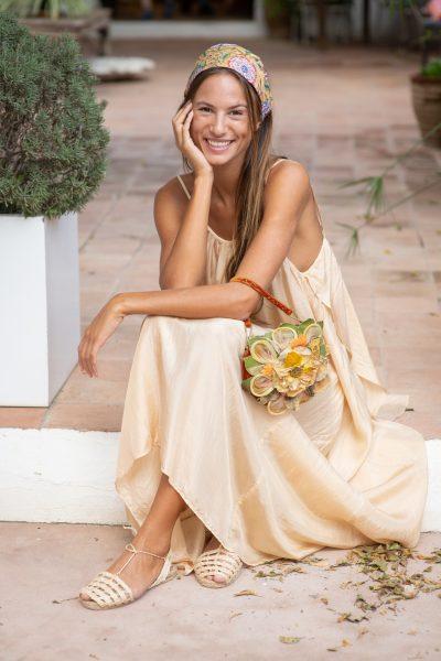 vintage bag worn with a gold dress