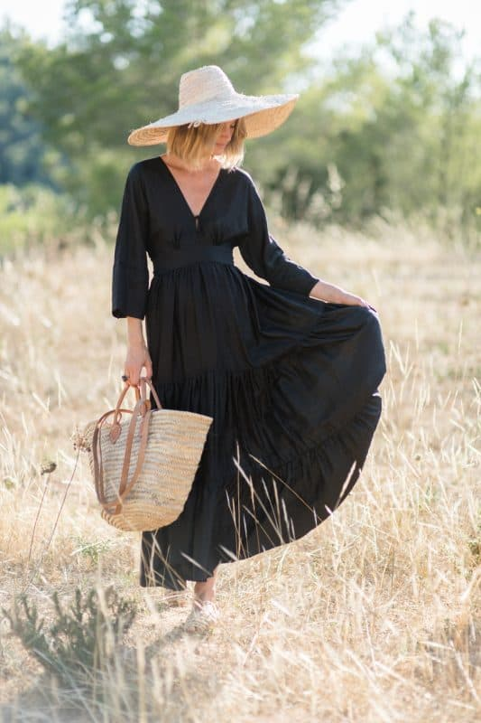 black Dres modelled with a straw basket and straw hat