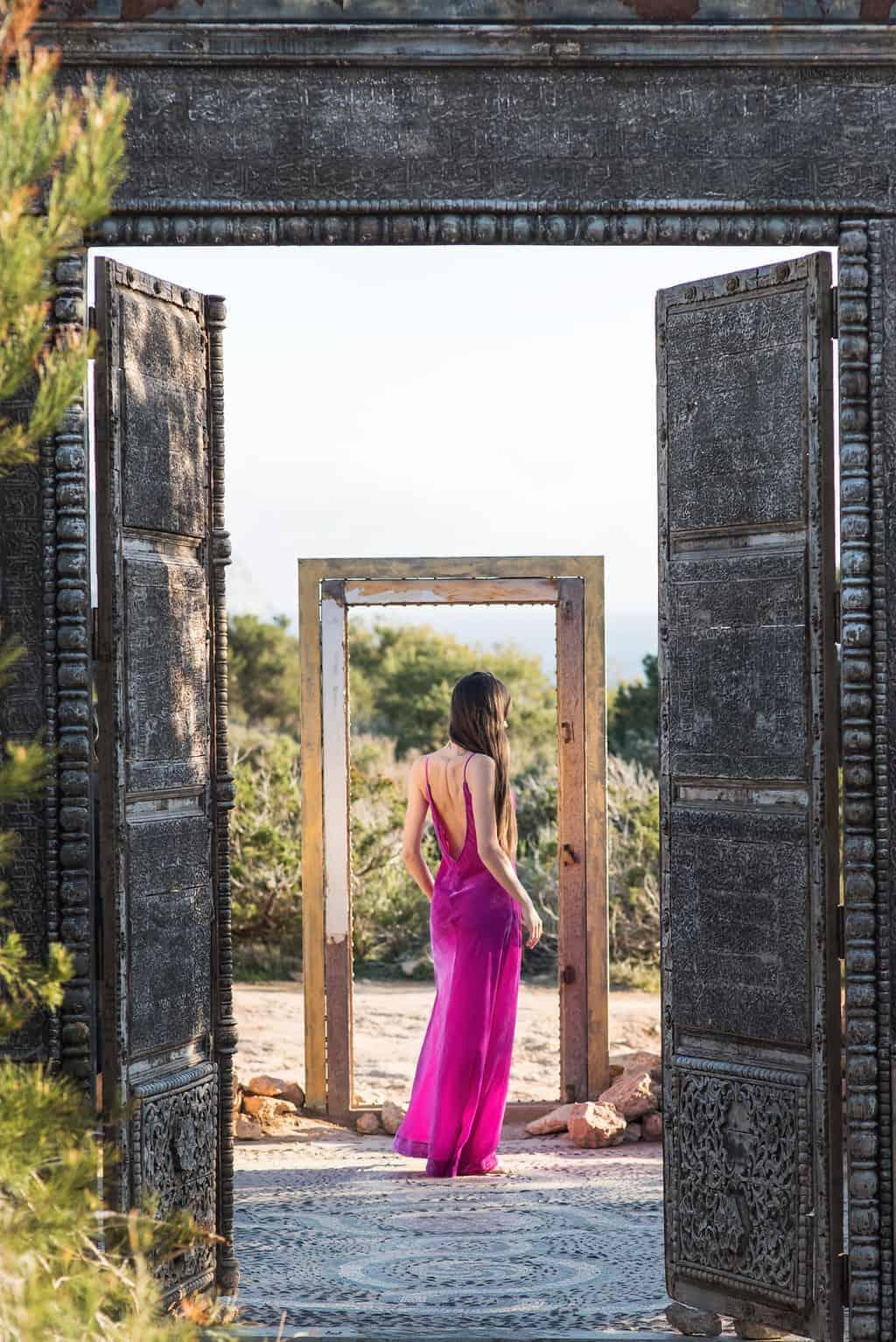 Ibiza beach style girl in a pink dress