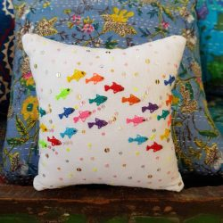 small square cushion with embroidered fish