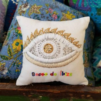 embroidered cushion with an eye and besoms de ibiza on it