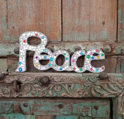 wooden sign of the word peace